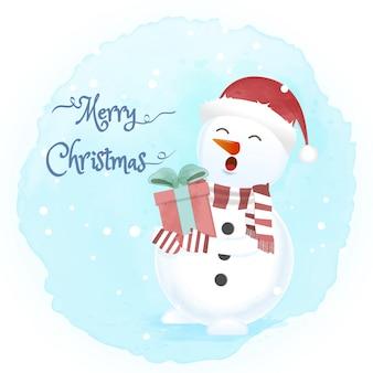 Schneemann hält geschenkbox