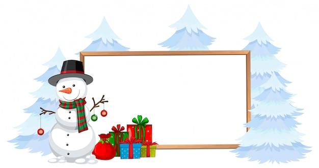 Schneemann mit feiertagsrahmen