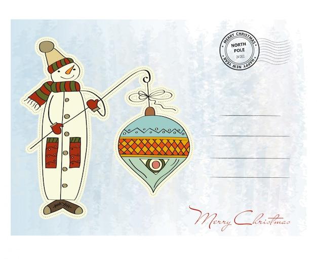 Schneemann mit großer weihnachtskugel