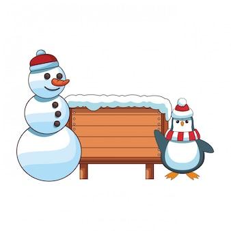 Schneemann und pinguin mit leerem holzschild