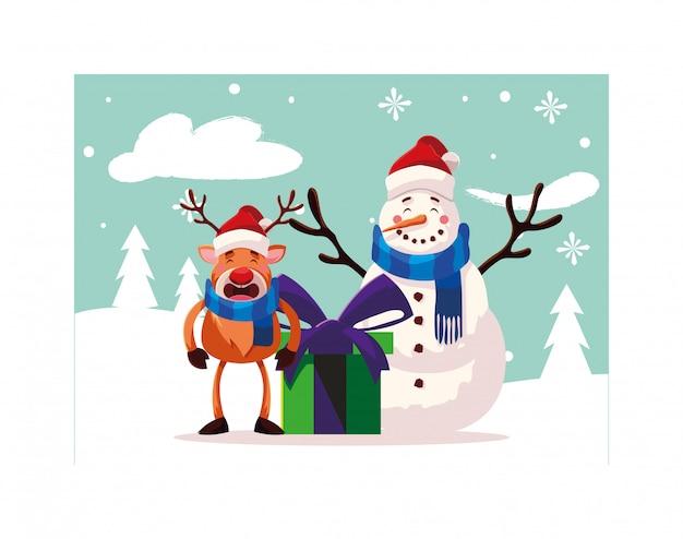 Schneemann und ren mit geschenkbox in der winterlandschaft