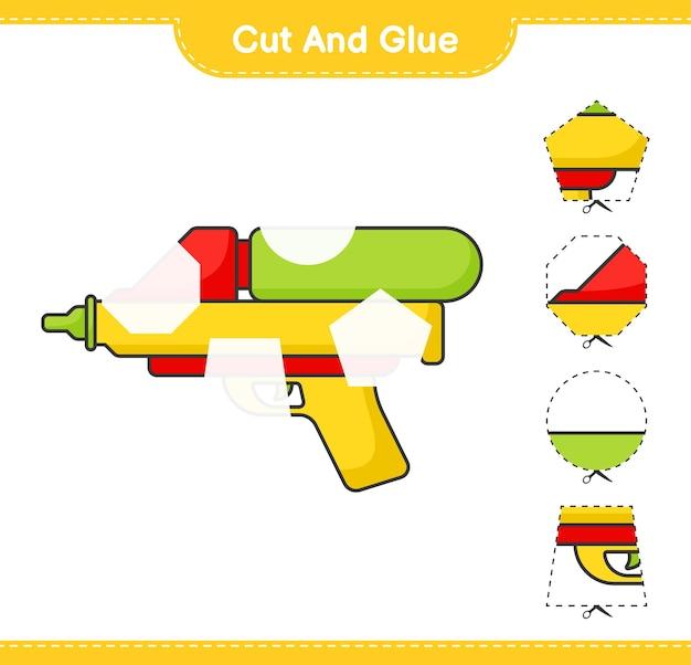 Schneiden und kleben sie die geschnittenen teile der wasserpistole und kleben sie sie auf