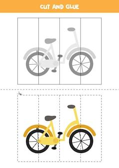 Schneiden und kleben spiel für kinder mit cartoon-fahrrad. schneidpraxis für kinder im vorschulalter.