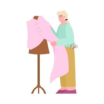 Schneiderei oder modeatelier mit näherin messstoff zum schneidern