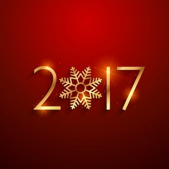 Schön 2017 text in der goldenen farbe mit schneeflocke auf rotem hintergrund