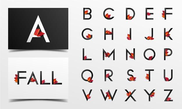 Schöne alphabetsammlung verziert mit roten realistischen blättern