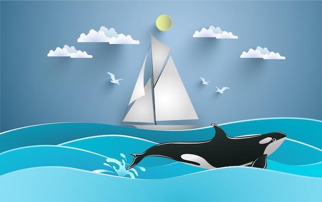 Schöne aussicht auf den ozean mit segelbooten und schwertwalwalen. papierkunst design