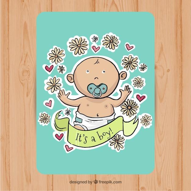 Schöne baby-dusche-karte mit niedlichen jungen und blumenschmuck