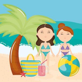 Schöne frauen paar mit badeanzug am strand