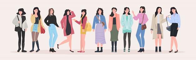 Schöne frauengruppe, die zusammen attraktive mädchen weibliche zeichentrickfiguren in modekleidung in voller länge flach horizontal steht