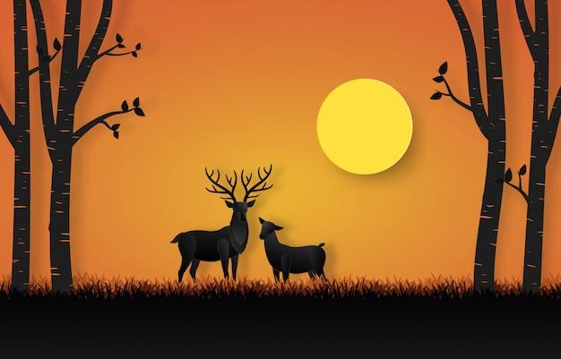 Schöne gehörnte rotwild im wald mit der familie umgeben durch bäume auf sonnenunterganghintergrund im papierschnittdesign.