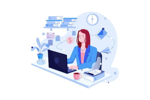Schöne geschäftsfrau, die laptop beim sitzen an ihrem schreibtisch verwendet