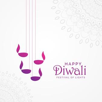 Schöne glückliche diwali kartenentwurf mit hängenden diya lampen und mandala dekoration