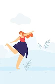 Schöne glückliche frau, die draußen flache fahne tanzt