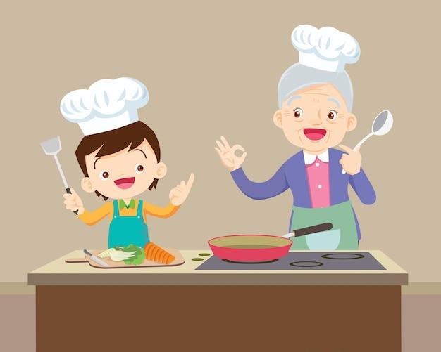 Schöne großmutter und kinderjunge kochen in der küche okay geste
