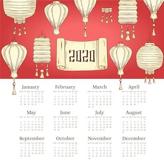 Schöne hand gezeichneter chinesischer kalender des neuen jahres mit steigung