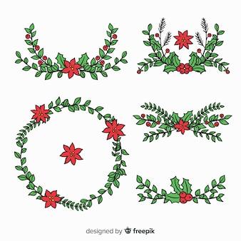 Schöne hand gezeichneter weihnachtsblumen- und -kranzsatz