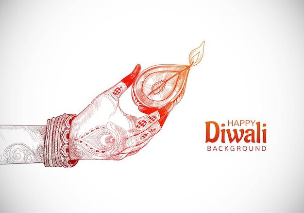 Schöne indische öllampe für hand, die diwali festivalhintergrund hält