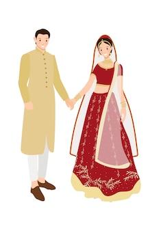 Schöne indische paarbraut und -bräutigam im roten traditionellen hochzeitssari kleiden an