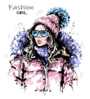 Schöne junge frau in winterkleidung.