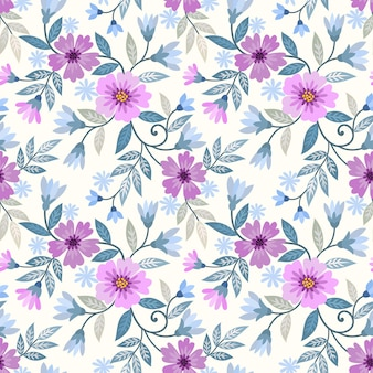 Schöne lila blumen und nahtloses muster des grünen blattes.