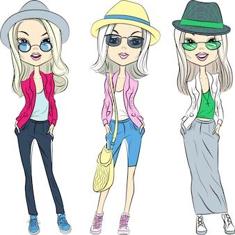 Schöne mode hipster mädchen in hüten, jacken, turnschuhen und brillen