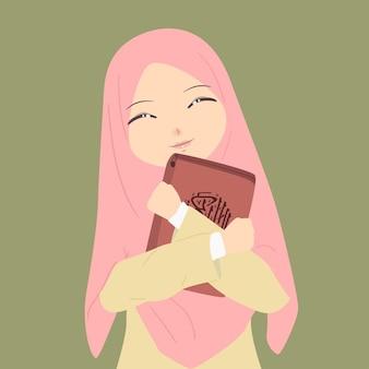 Schöne muslimische frauen tragen hijab lächelnd, während sie den koran halten