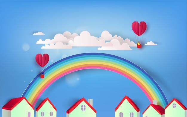 Schöne regenbogen- und herzballone über stadt