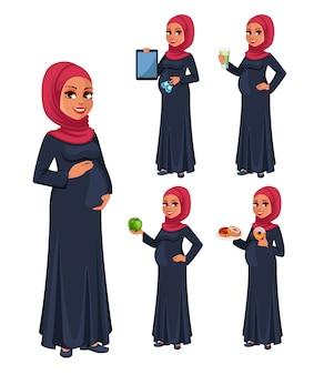 Schöne schwangere moslemische frau im hijab
