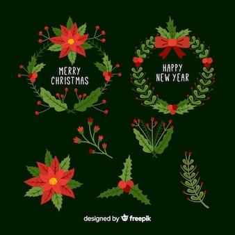 Schöne weihnachtsblumen- und -kranzansammlung