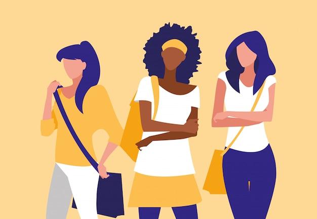 Schöne zwischen verschiedenen rassen mädchengruppe, die mit handtasche modelliert