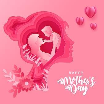 Schönen muttertag. grußkartenillustration von mutter und baby innerhalb der papierschnittfrauenkopfschattenbild