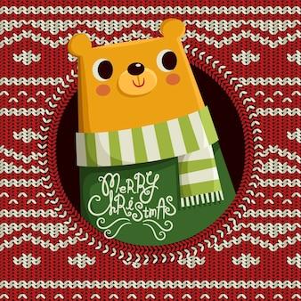 Schöner bär lokalisiert auf gestricktem weihnachtshintergrund
