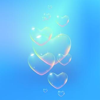 Schöner blauer hintergrund mit regenbogenfarbener herzförmiger seifenblasen-vektorillustration