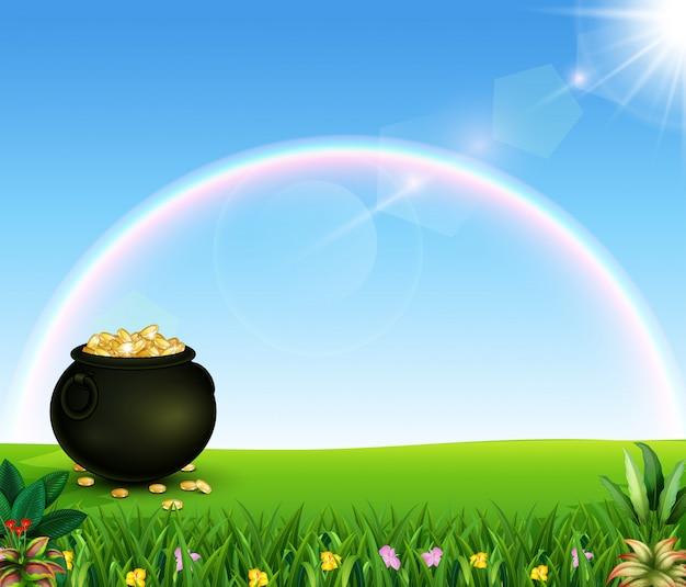 Schöner regenbogen mit einem topf münzen auf dem feld