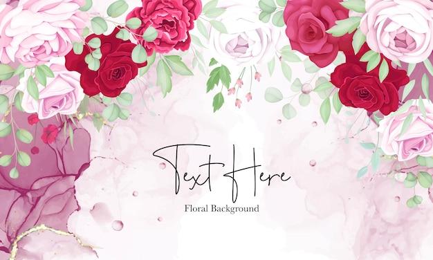 Schöner roter und rosa blumenrahmenhintergrund mit eleganter alkoholtinte