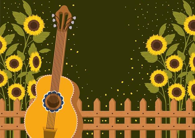Schöner sonnenblumengarten mit zaun und gitarre