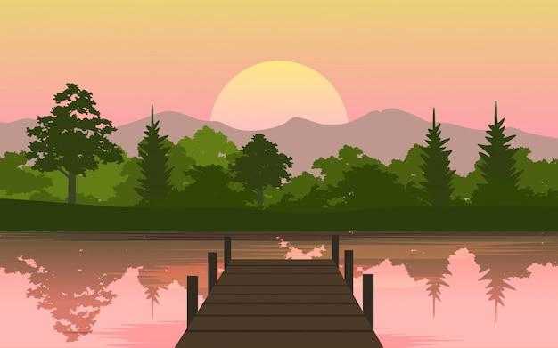 Schöner sonnenuntergang am see mit dock
