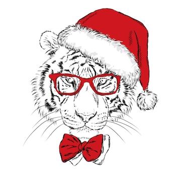 Schöner tiger in einer weihnachtsmütze. weihnachten.