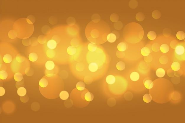 Schönes goldenes bokeh beleuchtet hintergrundtapetendesign