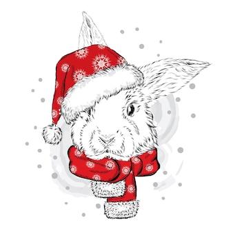 Schönes kaninchen in einer weihnachtsmütze. weihnachten und neujahr.