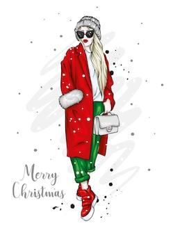 Schönes mädchen in einem mantel und einem hut. weihnachten.