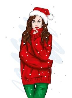 Schönes mädchen in einem pullover und einer weihnachtsmannmütze