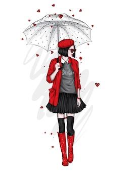 Schönes mädchen in einem stilvollen mantel, stiefel, schal und mütze. frühlings- oder herbstkleidung und regenschirm.
