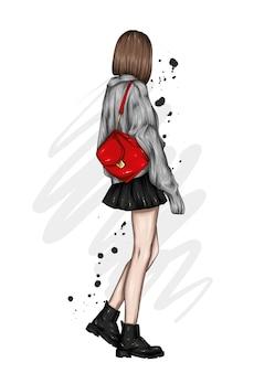 Schönes mädchen in einem stilvollen pullover und mit einem rucksack