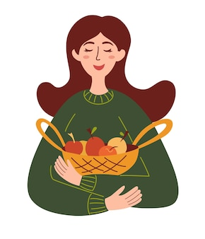 Schönes mädchen mit einem korb mit äpfeln erntesaison gesundes lebensmittelkonzept bauernhofprodukte