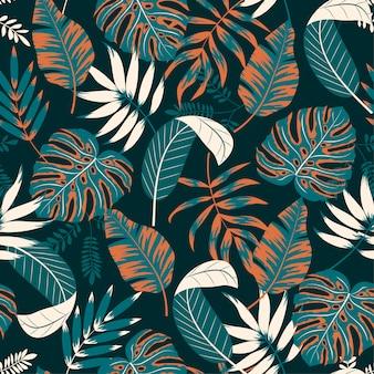 Schönes nahtloses muster mit tropischen pflanzen und blättern