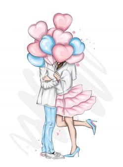 Schönes paar mit luftballons in form von herzen.