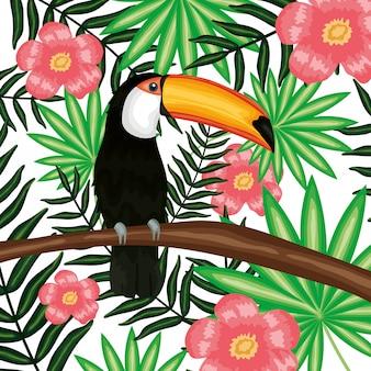 Schönes tukan mit exotischer und tropischer blumendekoration