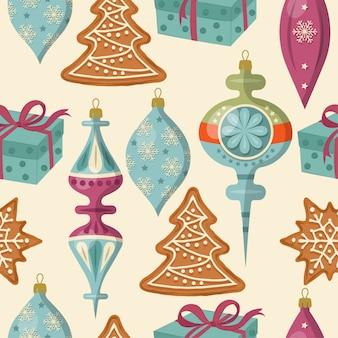 Schönes weihnachtsnahtloses muster mit weihnachtsbällen und -lebkuchen